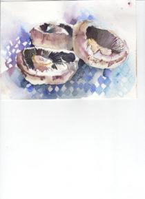 Three mushrooms on a blue gingham cloth