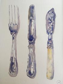 Silver fork and knofe plus ornatelt decorated knifeon plain background