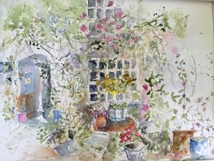 Rambling flowers, urns around an old house bathed in high summer sunshine.